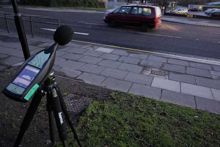 Traffic noise levels being measured at an out of town retail park