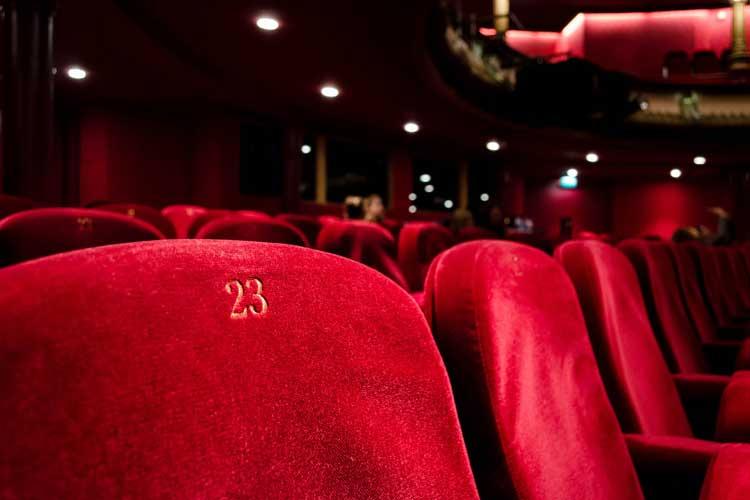 Cinema interior with surround sound acoustics
