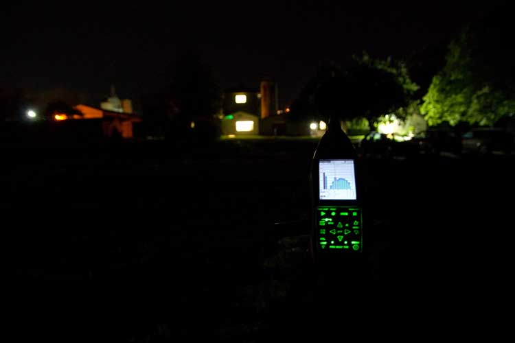 Noise recording equipment being used at night in a residential setting